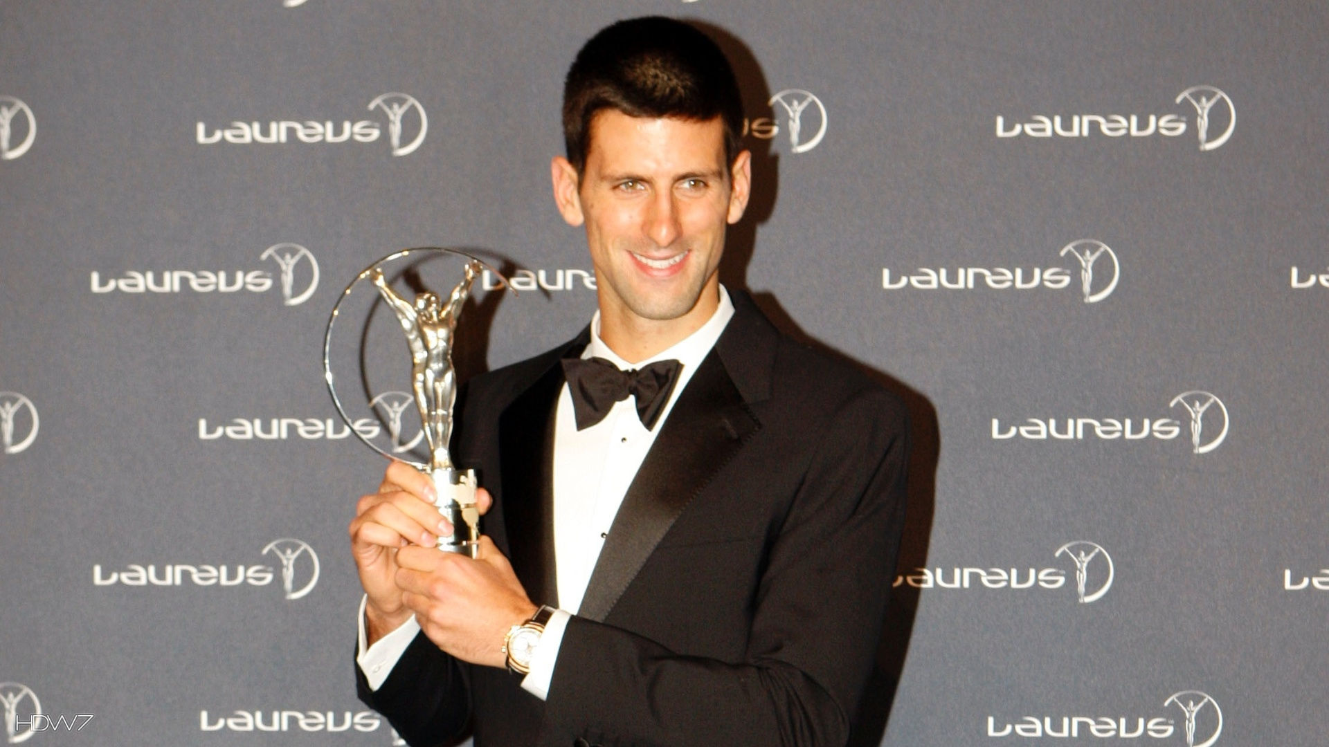 nole with laureus sportsman of the year award 2011
